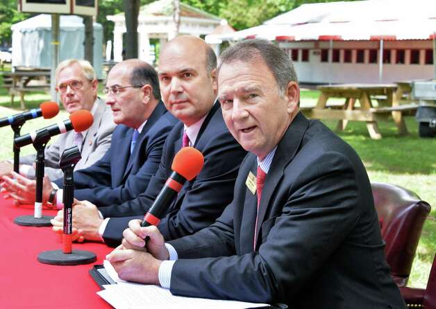 NYRA CEO and President Chris Kay, right, is joined by safety steward Hugh Gallagher, left, racing secretary Frank Gabriel and VP and director of racing operations Martin Panza, second from right, for a news conference Wednesday July 16, 2014, at Saratoga Race Course in Saratoga Springs, N.Y.  (John Carl D'Annibale / Times Union) Photo: John Carl D'Annibale / 00027812A