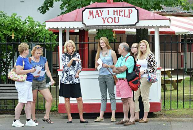 Guest Services' Linda Davis, third from left, and staff ready for the start of the new racing season at Saratoga Race Course Wednesday, July 16, 2014, in Saratoga Springs, NY.  (John Carl D'Annibale / Times Union) Photo: John Carl D'Annibale / 00027812A