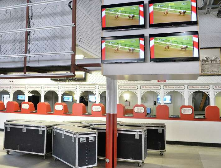 New HD televisions are installed near betting windows at Saratoga Race Course Wednesday, July 16, 20