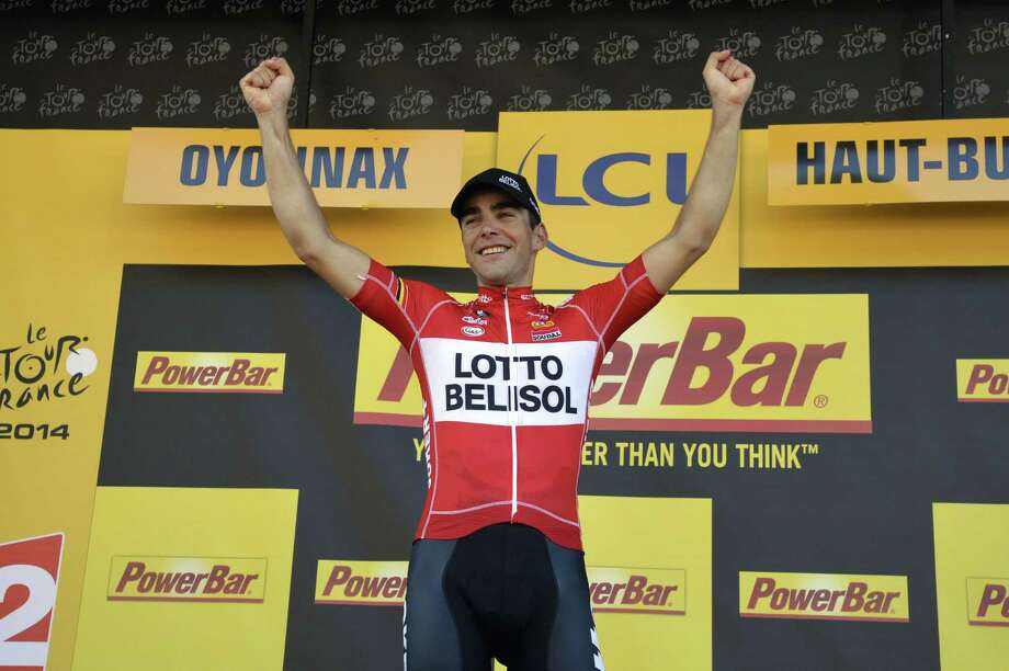Stage winner France's Tony Gallopin celebrates on the podium after winning the 187.5 km eleventh stage of the 101st edition of the Tour de France cycling race on July 16, 2014 between Besancon and Oyonnax, eastern France.  AFP PHOTO / ERIC FEFERBERGERIC FEFERBERG/AFP/Getty Images Photo: ERIC FEFERBERG, Staff / ERIC FEFERBERG