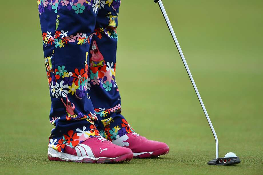 Trouser alert:John Daly hopes his pants will scare the ball into the cup at Royal Liverpool in Hoylake, England, 