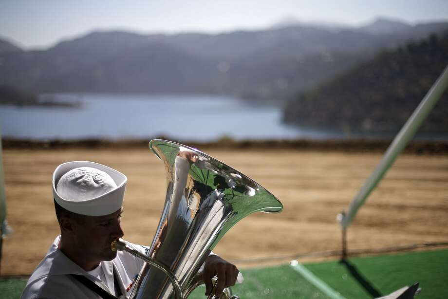 Navy Musician Third Class John Wylie plays a tuba during a ceremony to dedicate the San Vicente Dam raise, in front of the San Vicente Reservoir Wednesday, July 16, 2014, in Lakeside, Calif. Crews have finished raising the dam, as California endures the worst drought in the state since the mid-1970s. (AP Photo/Gregory Bull) Photo: Gregory Bull, Associated Press