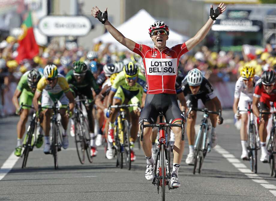 France's Tony Gallopin manages to stay ahead of the spring pack, rear, as he crosses the finish line to win the eleventh stage of the Tour de France cycling race over 187.5 kilometers (116.5 miles) with start in Besancon and finish in Oyonnax, France, Wednesday, July 16, 2014. (AP Photo/Peter Dejong) Photo: Peter Dejong, Associated Press