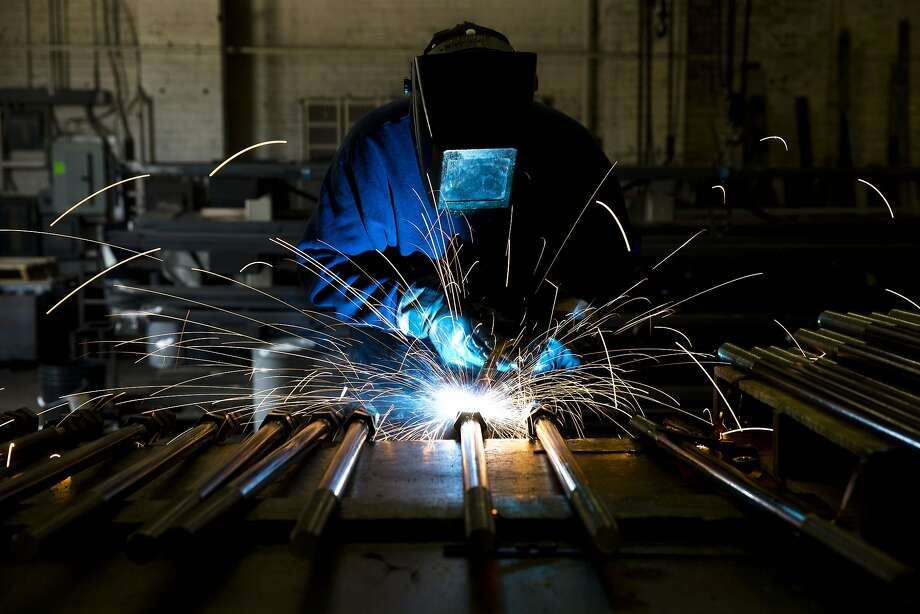 Welder Al Macchione works at custom manufacturer Fox Company Inc., Wednesday, July 16, 2014, in Philadelphia. (AP Photo/Matt Rourke) Photo: Matt Rourke, Associated Press