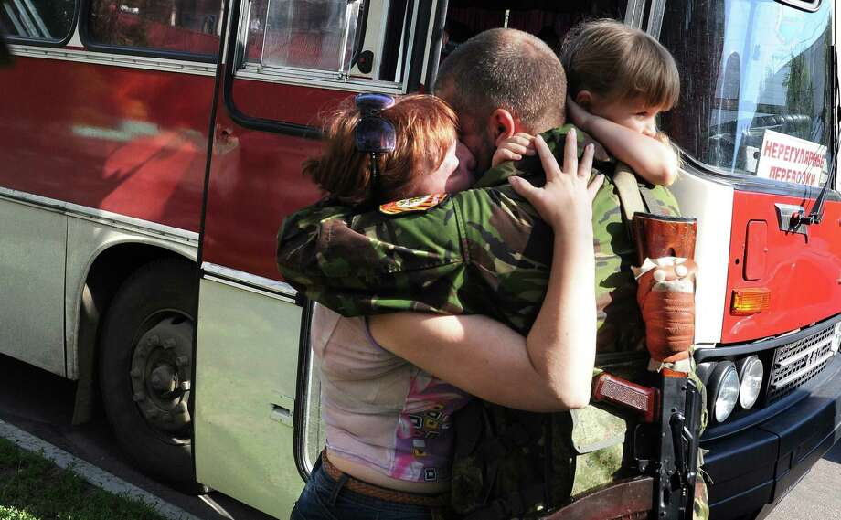 A pro-Russian militant bids his family farewell in Donetsk, Ukraine, as they prepare to leave for Russia before expected fighting. Photo: DOMINIQUE FAGET / AFP / Getty Images / AFP