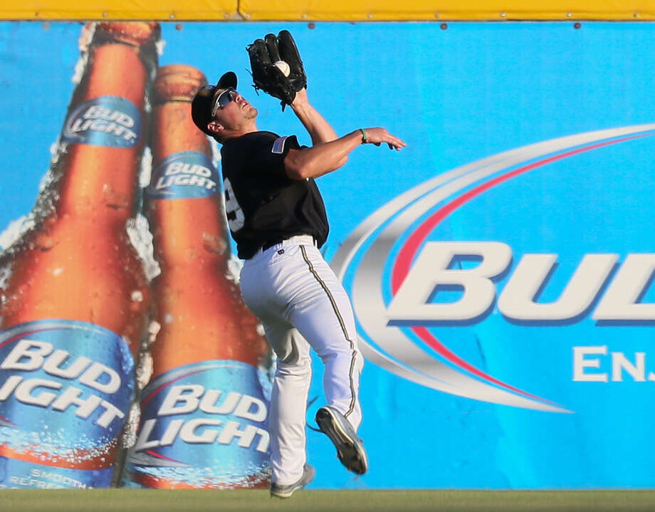 The Missions' Hunter Renfroe makes an over-the-shoulder catch in right-center field during the second inning at Wolff Stadium. The center fielder had a single in the victory over Frisco. Photo: Marvin Pfeiffer / San Antonio Express-News / Express-News 2014