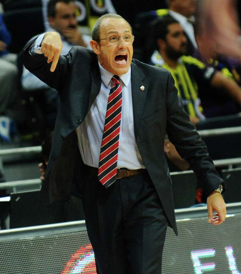 New Spurs assistant coach Ettore Messina has a Gregg Popovich-like résumé overseas with four Euroleague championships. Spurs guard Manu Ginobili says he learned how to be a team player during his two seasons playing under Messina in Italy. Photo: Bulent Kilic / AFP / Getty Images / 2013 AFP
