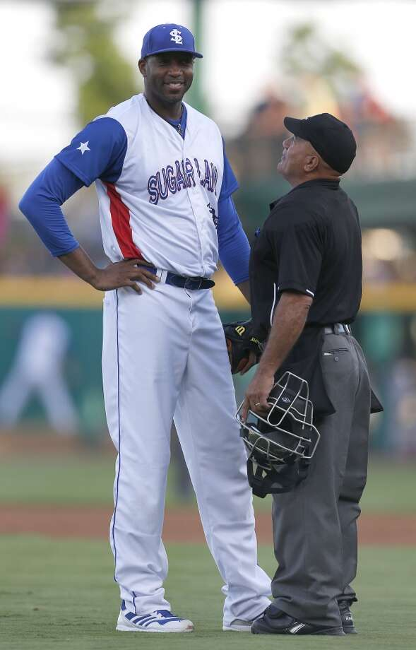 Skeeters pitcher Tracy McGrady chats with home plate umpire Manolo Alejandro in the second inning of the Atlantic League All-Star game at Constellation Field, Wednesday, July 16, 2014, in Sugar Land. ( Karen Warren / Houston Chronicle  ) Photo: Karen Warren, Houston Chronicle