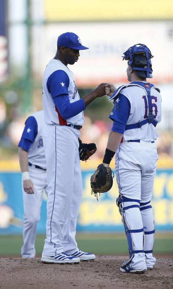 Skeeters pitcher Tracy McGrady fist bumps catcher Travis Scott, just before getting taken out of the game in the second inning of the Atlantic League All-Star game at Constellation Field, Wednesday, July 16, 2014, in Sugar Land. ( Karen Warren / Houston Chronicle  ) Photo: Karen Warren, Houston Chronicle