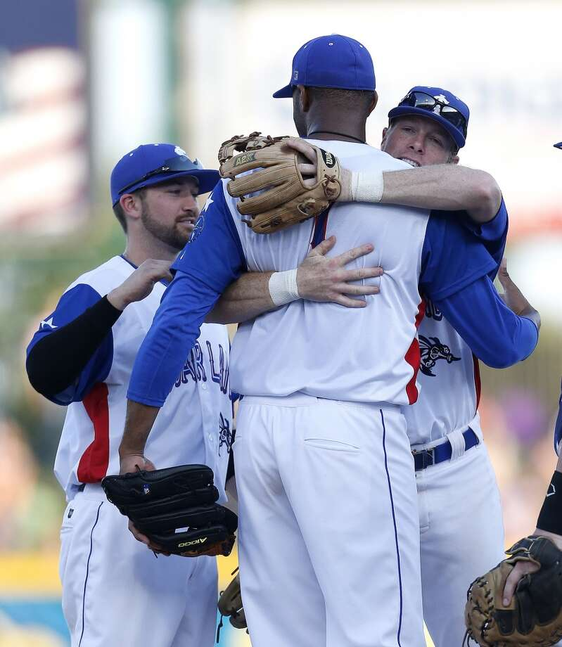 Skeeters pitcher Tracy McGrady hugs Chase Lambin, just before getting taken out of the game in the second inning of the Atlantic League All-Star game at Constellation Field, Wednesday, July 16, 2014, in Sugar Land. ( Karen Warren / Houston Chronicle  ) Photo: Karen Warren, Houston Chronicle