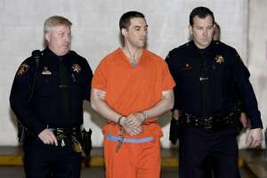 Convicted murderer Scott Peterson is seen being escorted by two San Mateo County sheriff's deputies on March 17, 2005, in Redwood City, California. Peterson was transported to Death Row at San Quentin Prison after being sentenced to death for the murder or his wife, Laci, and their unborn son. Laci Peterson of Modesto was last seen on Christmas Eve 2002.