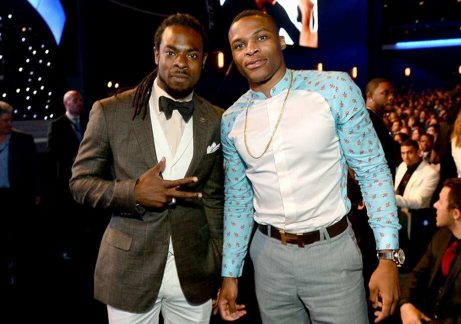 Richard Sherman, left, and Russell Westbrook pose in the audience at the ESPY Awards at the Nokia Theatre on Wednesday, July 16, 2014, in Los Angeles. (Photo by Jordan Strauss/Invision/AP) Photo: Jordan Strauss, Associated Press