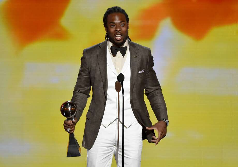 Richard Sherman, of the Seattle Seahawks, accepts the award for best breakthrough athlete at the ESPY Awards at the Nokia Theatre on Wednesday, July 16, 2014, in Los Angeles. (Photo by John Shearer/Invision/AP) Photo: John Shearer, Associated Press