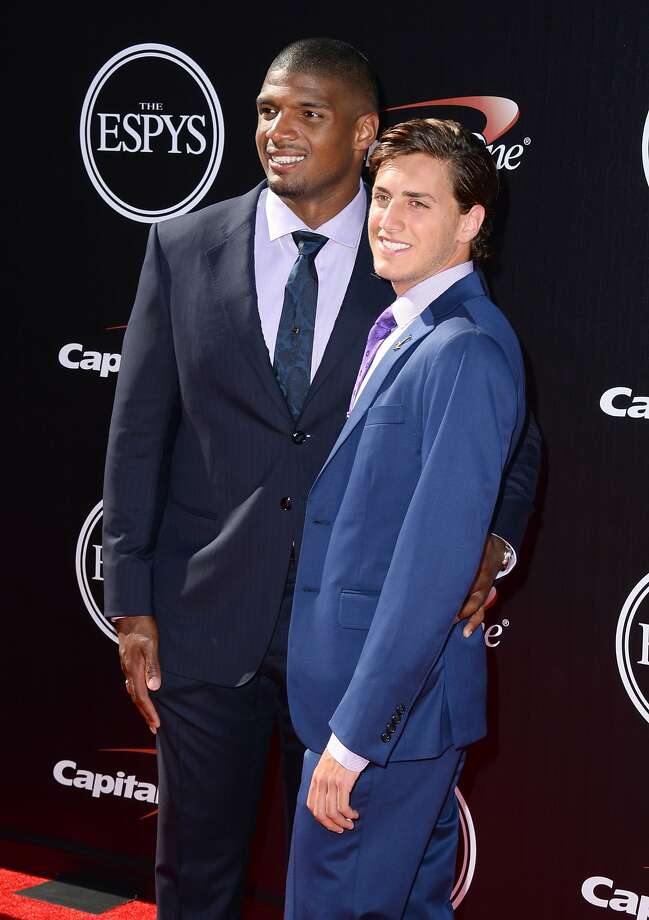 St. Louis Rams' Michael Sam, left, and Vito Cammisano arrive at the ESPY Awards at the Nokia Theatre on Wednesday, July 16, 2014, in Los Angeles. (Photo by Jordan Strauss/Invision/AP) Photo: Jordan Strauss, Associated Press