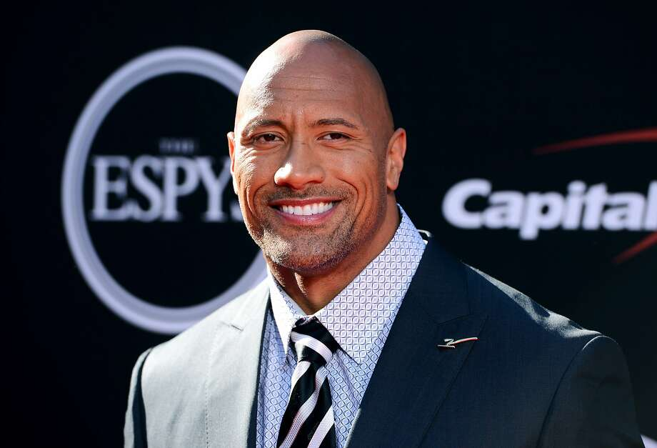 Actor Dwayne Johnson arrives at the ESPY Awards at the Nokia Theatre on Wednesday, July 16, 2014, in Los Angeles. (Photo by Jordan Strauss/Invision/AP) Photo: Jordan Strauss, Associated Press