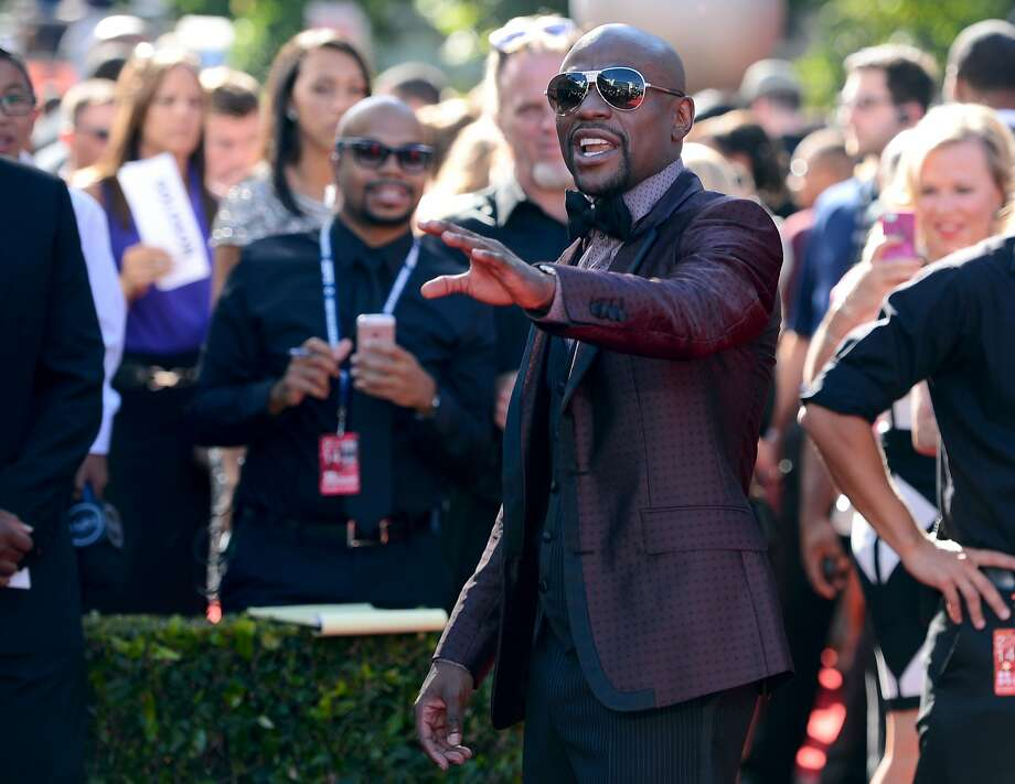 Boxer Floyd Mayweather Jr. arrives at the ESPY Awards at the Nokia Theatre on Wednesday, July 16, 2014, in Los Angeles. (Photo by Jordan Strauss/Invision/AP) Photo: Jordan Strauss, Associated Press