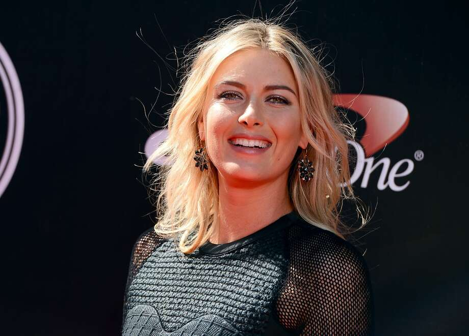 Tennis player Maria Sharapova arrives at the ESPY Awards at the Nokia Theatre on Wednesday, July 16, 2014, in Los Angeles. (Photo by Jordan Strauss/Invision/AP) Photo: Jordan Strauss, Associated Press