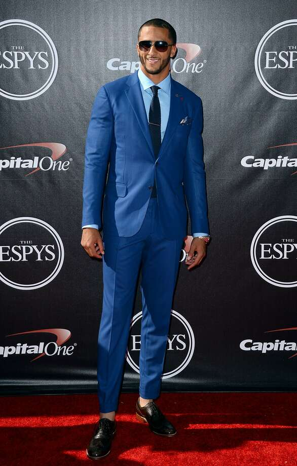 San Francisco 49ers' Colin Kaepernick arrives at the ESPY Awards at the Nokia Theatre on Wednesday, July 16, 2014, in Los Angeles. (Photo by Jordan Strauss/Invision/AP) Photo: Jordan Strauss, Associated Press