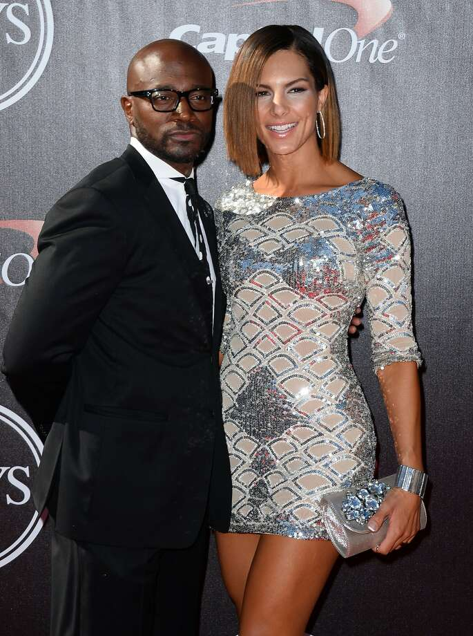 Taye Diggs, left, and Amanza Smith Brown arrive at the ESPY Awards at the Nokia Theatre on Wednesday, July 16, 2014, in Los Angeles. (Photo by Jordan Strauss/Invision/AP) Photo: Jordan Strauss, Associated Press