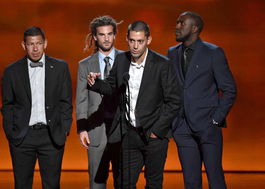 Team captain Clint Dempsey, center, and fellow members of the U.S. men's soccer team accept the award for best moment, at the ESPY Awards at the Nokia Theatre on Wednesday, July 16, 2014, in Los Angeles. (Photo by John Shearer/Invision/AP) Photo: John Shearer, Associated Press