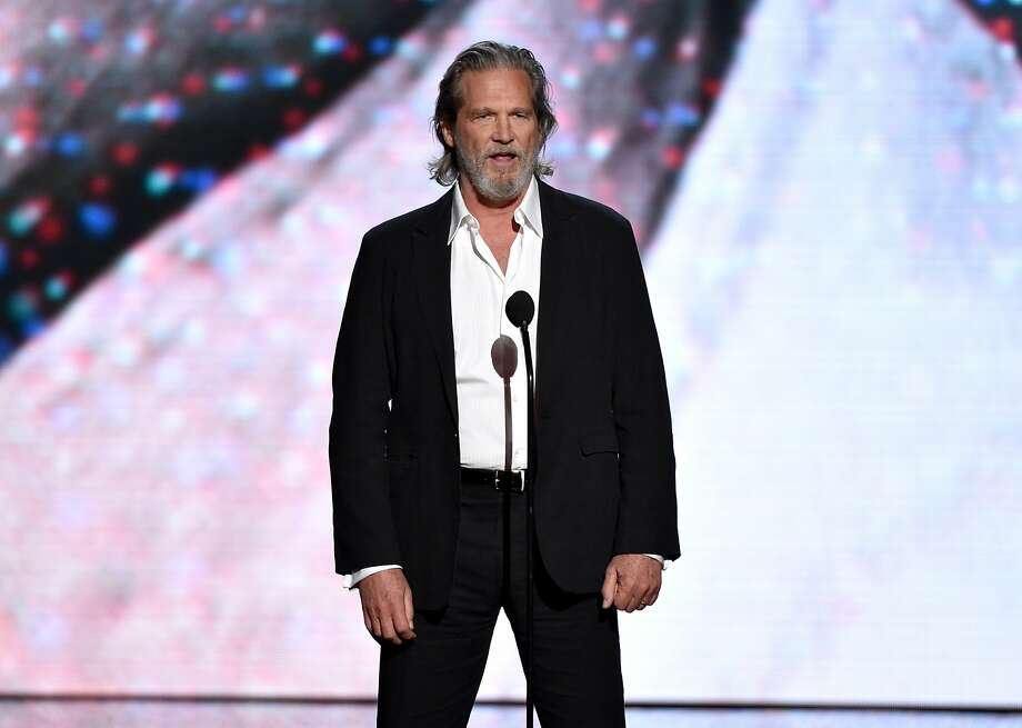 Jeff Bridges presents the Pat Tillman award for service Olympic sledge hockey player Josh Sweeney at the ESPY Awards at the Nokia Theatre on Wednesday, July 16, 2014, in Los Angeles. (Photo by John Shearer/Invision/AP) Photo: John Shearer, Associated Press