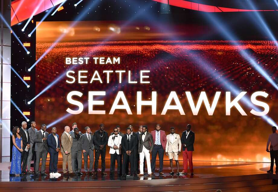 Russell Wilson and Seattle Seahawks accepts the award for best team at the ESPY Awards at the Nokia Theatre on Wednesday, July 16, 2014, in Los Angeles. (Photo by John Shearer/Invision/AP) Photo: John Shearer, Associated Press