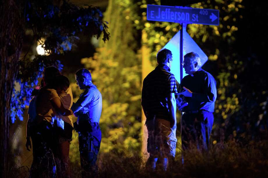 Victims and responders gather at the site of a motorboat versus sailboat collision around 10:30 PM Wednesday, July 16, 2014, on the western shores of Lake Washington in Seattle, Wash. At least four people involved in the crash were pulled from the water. Three people were listed in critical condition and transported to Harborview Medical Center, and a fourth victim died on scene. Photo: JOSHUA BESSEX, SEATTLEPI.COM / SEATTLEPI.COM