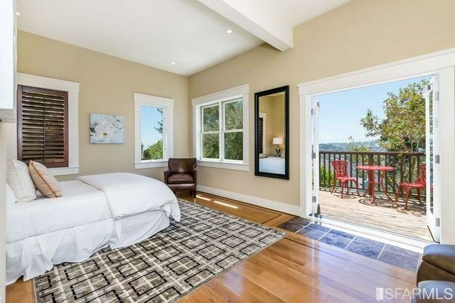 This bedroom has a walk-out balcony. Photo: MLS