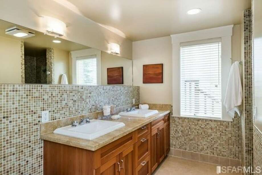 A remodeled bath with double vanity. Photo: MLS