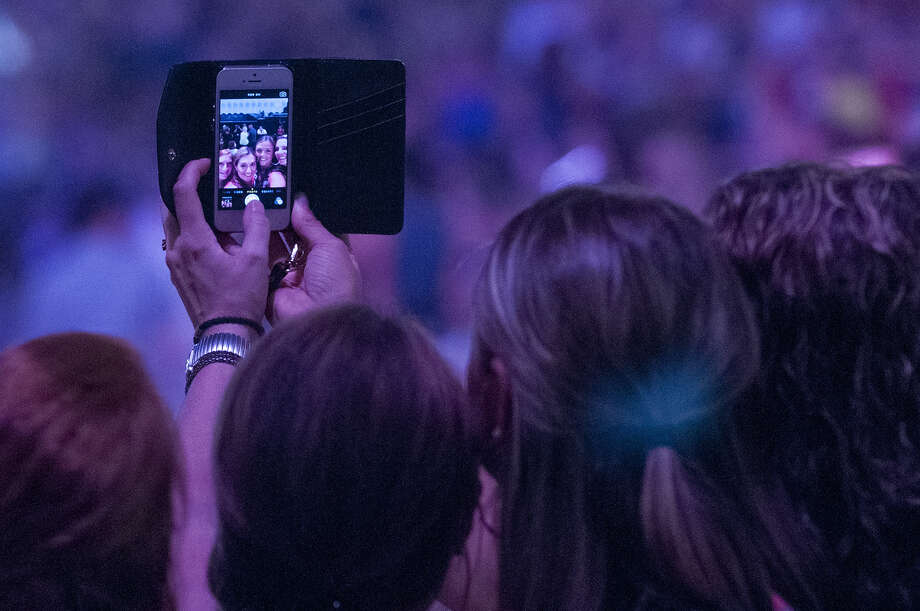 Concert goers take a selfie before the start of the Justin Timberlake concert at the Times Union Center on Wednesday, July 16, 2014 in Albany, N.Y.  (Tom Brenner/ Special to the Times Union) ORG XMIT: MER2014071707052807 Photo: Tom Brenner / ©Tom Brenner/ Albany Times Union