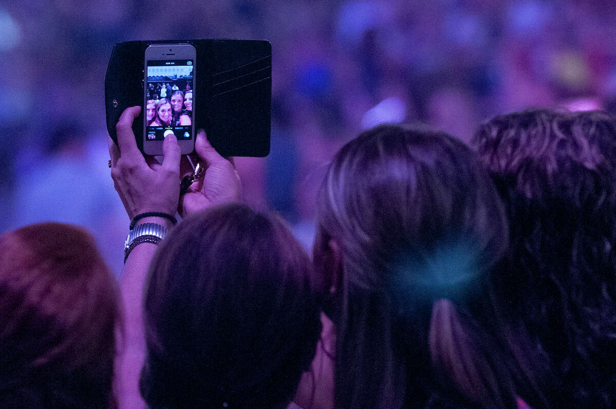 Concert goers take a selfie before the start of the Justin Timberlake concert at the Times Union Center on Wednesday, July 16, 2014 in Albany, N.Y. (Tom Brenner/ Special to the Times Union)
