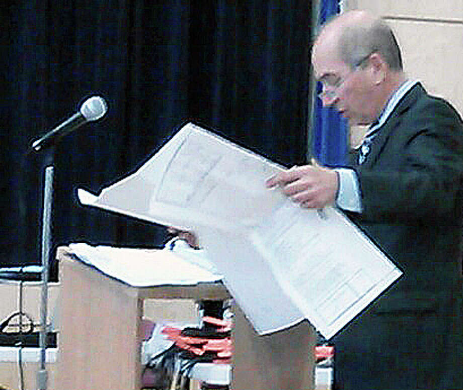 Joel Z. Green, the lawyer for opponents of a proposed 95-unit apartment building on lower Bronson Road, wraps up his presentation to the Town Plan and Zoning Commission Wednesday night in McKinley School. Photo: Andrew Brophy / Fairfield Citizen