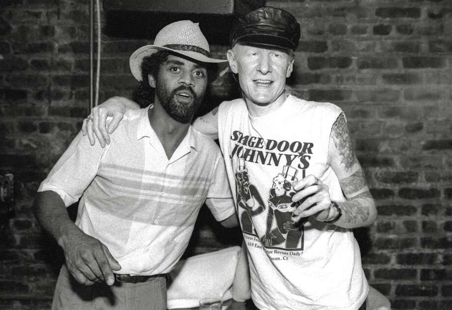 Portrait of American blues musician Kenny Neal (left) and blues and rock musician Johnny Winter pose together after a set by Neal at Manny's Car Wash, New York, New York, August 14, 1990.  Photo: Getty Images