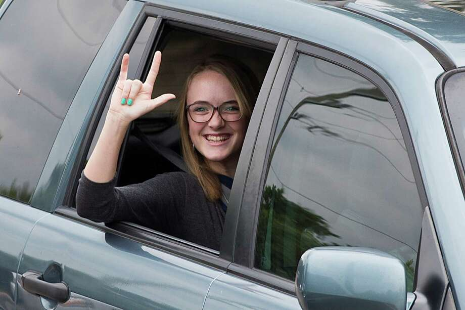 Cassidy Stay gestures as she arrives to The Church of Jesus Christ of Latter-day Saints for the funeral services of six members of her family Wednesday, July 16, 2014, in Houston. Ronald Lee Haskell is accused of killing the family members at their Spring home. Photo: Brett Coomer, Houston Chronicle / © 2014 Houston Chronicle
