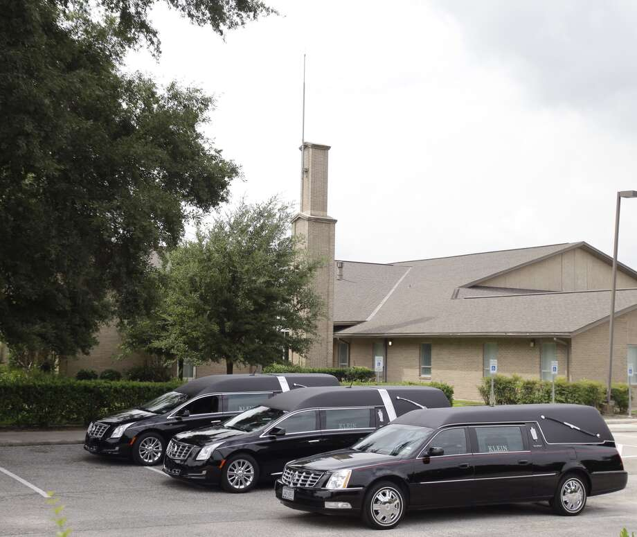 Hearses sit outside The Church of Jesus Christ of Latter-day Saints,16331 Hafer Road, for the funeral service of six members of the Stay family Wednesday, July 16, 2014. Photo: Melissa Phillip / Houston Chronicle