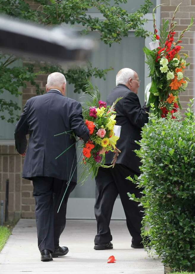 Flowers are carried into The Church of Jesus Christ of Latter-day Saints ,16331 Hafer Road, for the funeral service of six members of the Stay family  Wednesday, July 16, 2014. Photo: Melissa Phillip, Houston Chronicle / © 2014  Houston Chronicle