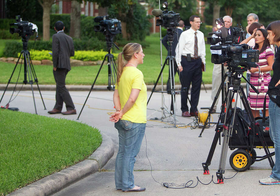 The media interviews Crystal Ross in front of Don Guthrie's home, Wednesday, July 16, 2014, in Spring. Katie Stay was Crystal's best friend. Photo: Cody Duty, Houston Chronicle / © 2014 Houston Chronicle