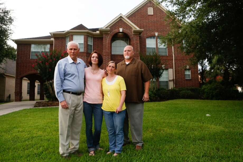 Don Guthrie, Moriah Davis, Crystal Ross and Thomas Mixon stand in front of Guthrie's home. All four knew the Stay family. Photo: Cody Duty / Houston Chronicle