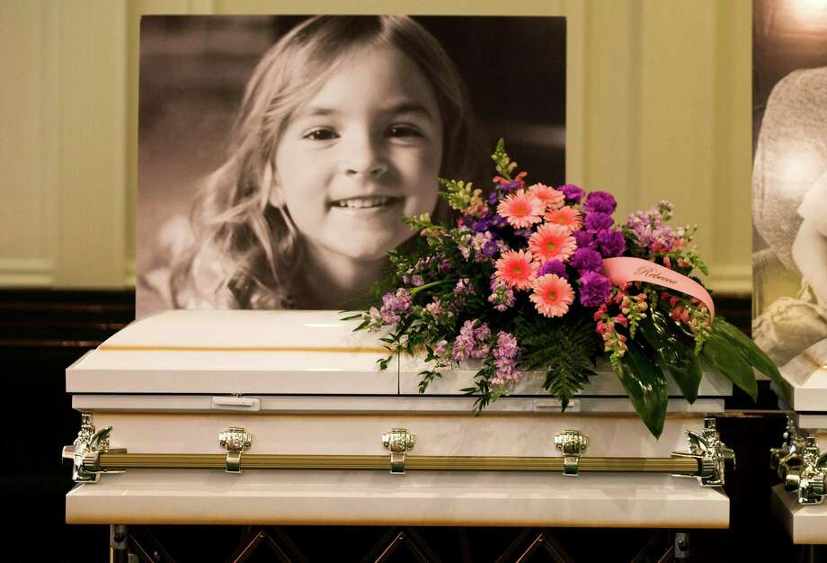 A photo of Rebecca Stay is laid above her casket before visitation at Klein Funeral Home Tuesday, July 15, 2014, in Spring. She is one of six slain in a mass shooting last week. Photo: Brett Coomer, Houston Chronicle / © 2014 Houston Chronicle
