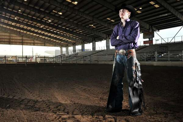 In this photo taken Wednesday, March 14, 2012, nineteen-year-old Cody Teel poses at the Rio Grande Valley Livestock Show in Mercedes, Texas, to compete in the extreme bull riding competition. (AP Photo/Dina Arevalo/Valley Morning Star)
