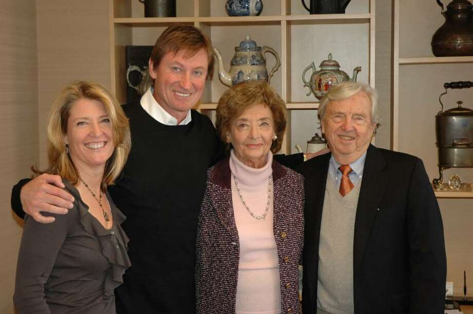 Cindi Bigelow, with hockey legend Wayne Gretzky, who lit the Olympic flame in Vancover, B.C., last week, and Eunice and David Bigelow. Photo: Contributed Photo / Connecticut Post Contributed