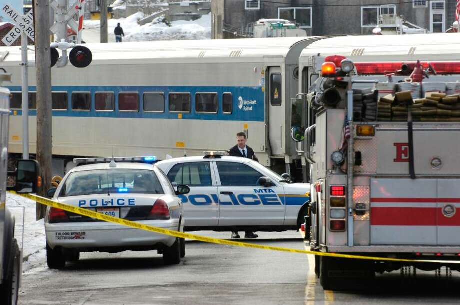 The aftermath of the scene where a Metro-North train appeared to have hit and killed a person Wednesday morning, Feb. 17th, 2010, as the train crossed Commerce Street just north of the Devine Bros. Inc. fuel depot., in central Norwalk. Photo: Bob Luckey / Stamford Advocate