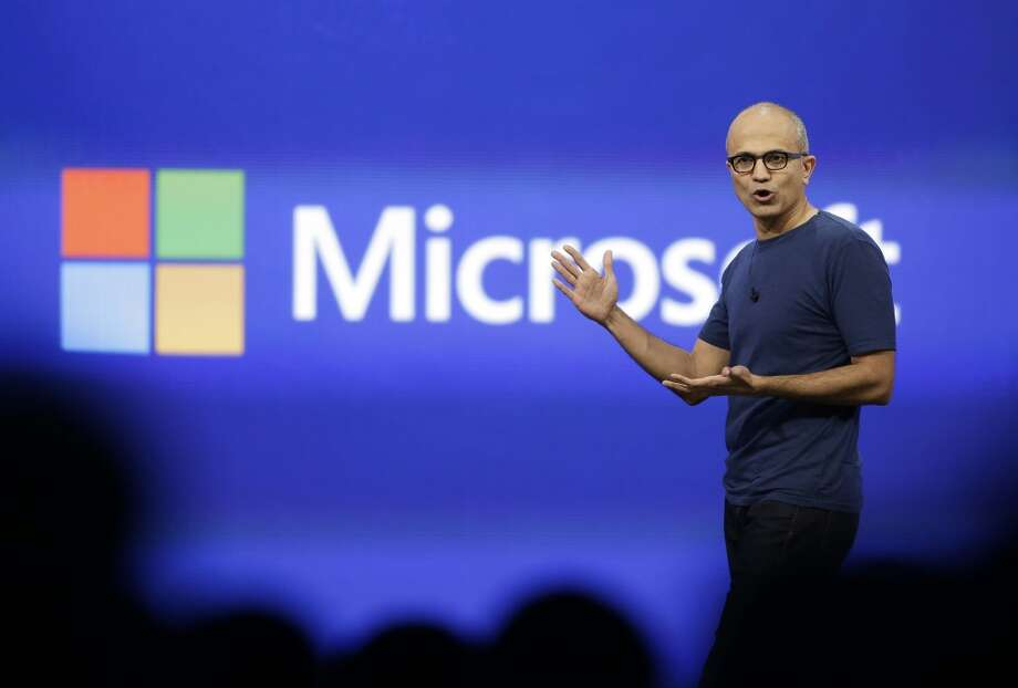 In this 2014 file photo, Microsoft CEO Satya Nadella gestures during the keynote address of the Build Conference in San Francisco. Microsoft on Thursday, July 17, 2014 announced it will lay off up to 18,000 workers over the next year. Photo: Eric Risberg, Associated Press