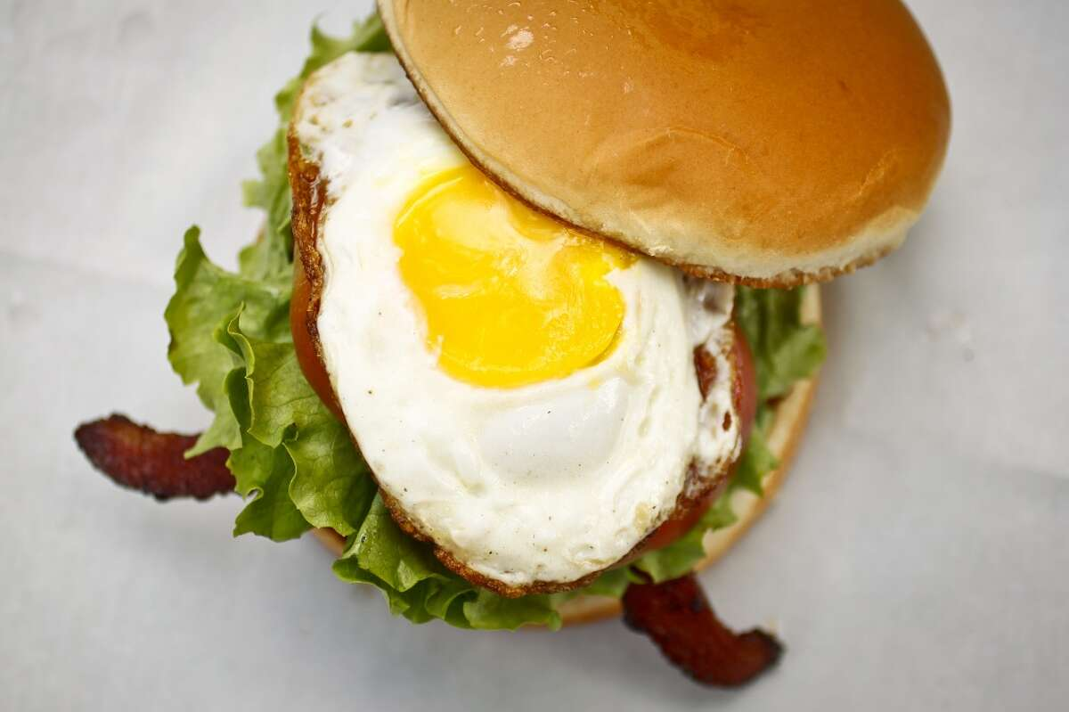 A burger topped with a fried egg at The Shack.