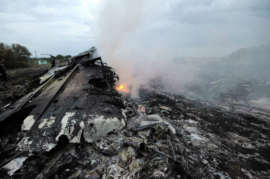 A picture taken on July 17, 2014 shows wreckages of the malaysian airliner carrying 295 people from Amsterdam to Kuala Lumpur after it crashed, near the town of Shaktarsk, in rebel-held east Ukraine. Pro-Russian rebels fighting central Kiev authorities claimed on Thursday that the Malaysian airline that crashed in Ukraine had been shot down by a Ukrainian jet. Photo: DOMINIQUE FAGET, AFP / AFP