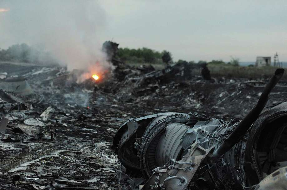 A picture taken on July 17, 2014 shows wreckages of the malaysian airliner carrying 295 people from Amsterdam to Kuala Lumpur after it crashed, near the town of Shaktarsk, in rebel-held east Ukraine. Pro-Russian rebels fighting central Kiev authorities claimed on Thursday that the Malaysian airline that crashed in Ukraine had been shot down by a Ukrainian jet. AFP PHOTO/DOMINIQUE FAGET Photo: DOMINIQUE FAGET, AFP / AFP