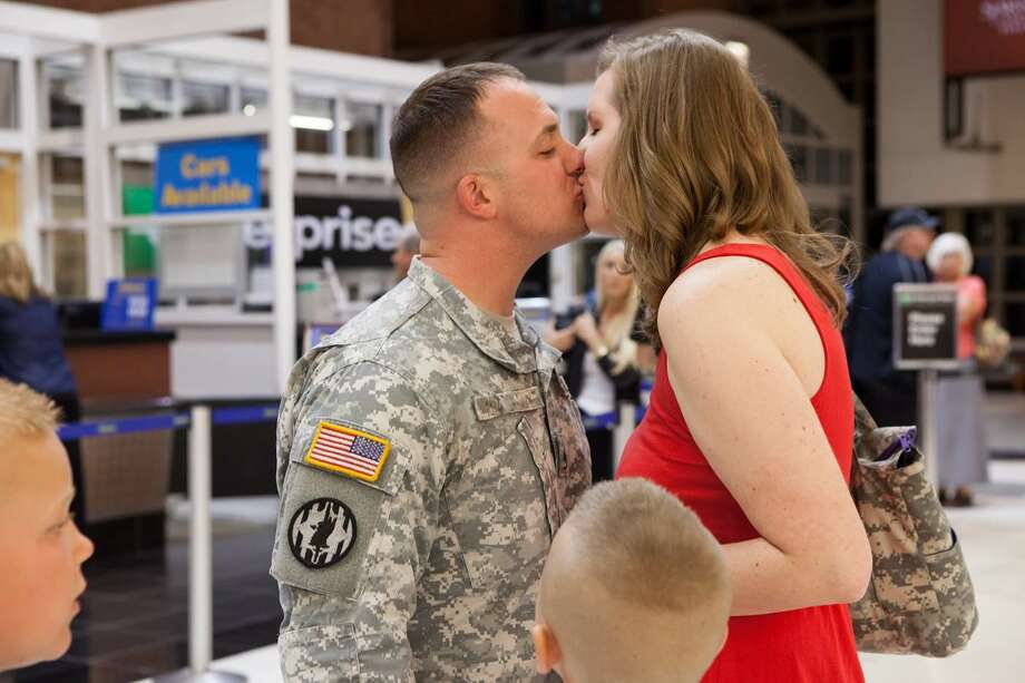 (Trisha Millier) Chris and Raquel Derrick embrace for the first time after a long deployment.