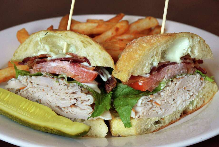 Irish turkey club sandwich at Harvey's Restaurant & Bar on Phila Street Thursday July 10, 2014, in Saratoga Springs, NY.  (John Carl D'Annibale / Times Union) Photo: John Carl D'Annibale / 00027692A