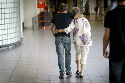 A couple walks to the location where more information will be given regarding the Malaysia Airlines plane traveling from Amsterdam to Kuala Lumpur that crashed near the town of Shaktarsk, in rebel-held east Ukraine, at Schiphol Airport near Amsterdam, the Netherlands on July 17, 2014. Malaysia Airlines said on July 17 that a passenger plane which crashed in eastern Ukraine was carrying 295 people, amid speculation it had been shot down. Photo: JEROEN JUMELET, AFP / AFP