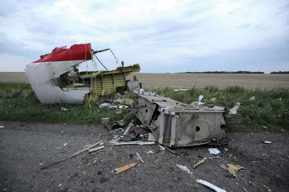 A picture taken on July 17, 2014 shows the wreckages of the malaysian airliner carrying 295 people from Amsterdam to Kuala Lumpur after it crashed, near the town of Shaktarsk, in rebel-held east Ukraine. Pro-Russian rebels fighting central Kiev authorities claimed on Thursday that the Malaysian airline that crashed in Ukraine had been shot down by a Ukrainian jet. The head of Ukraine's air traffic control agency said Thursday that the crew of the Malaysia Airlines jet that crashed in the separatist east had reported no problems during flight. Photo: DOMINIQUE FAGET, AFP / AFP